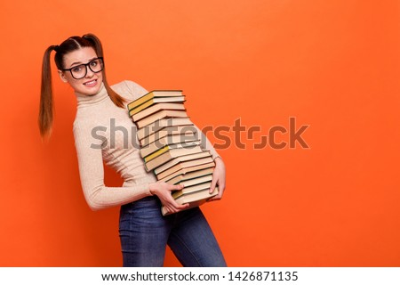 Close up side profile photo beautiful she her lady funny hairdo oh no hard work stupor hold arms hands many books prepare examination wear casual pastel pullover clothes isolated orange background