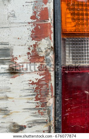 Stock Photo Close up side view damage taillight with body of old white car, vintage broken car crash rear light.