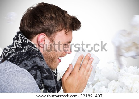 Close up side view of man blowing nose against white background with vignette #321891407