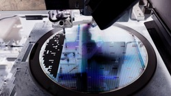 Close up silicon wafer negative color in die attach machine in semiconductor manufacturing