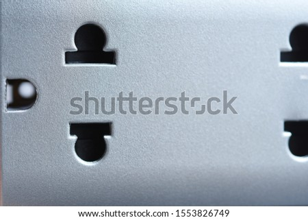 Close up silver duplex plug, electrical wall outlet. Power receptacle, energy and household appliance concept. #1553826749