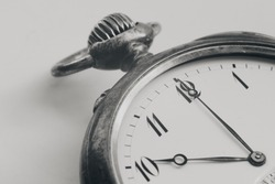 Close Up silver old pocket watch. Vintage timepiece. Antique concept. Black and white images.