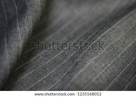 close up silver texture fabric of suit, photoshoot by depth of field for object