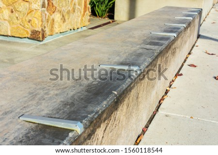 Close up. Skateboard prevention device installed on wood covered surface to prevent surface damage. #1560118544