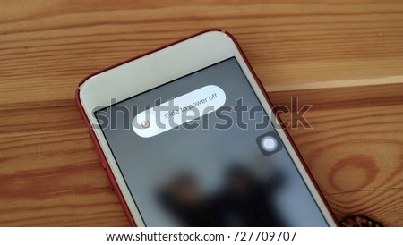 Close up smart phone with power off on the screen, wood background. #727709707