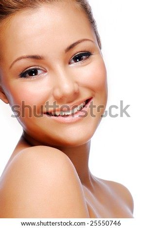 Close-up smiling face of young adult beautiful woman