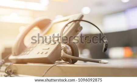 close up soft focus on telephone devices at office desk of customer service support concept #1096092875