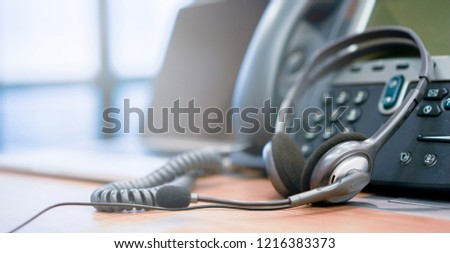 close up soft focus on telephone devices at office desk of customer service support concept
