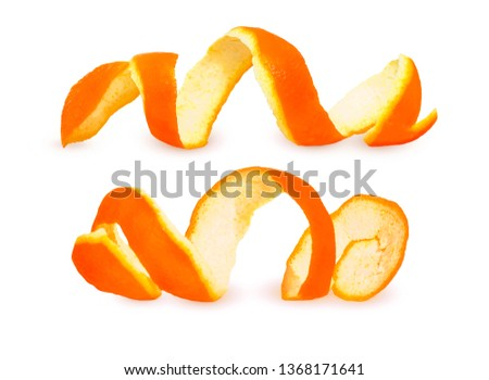Close-up Spiral peeled fresh orange peels isolated on white background. Two citrus peels #1368171641