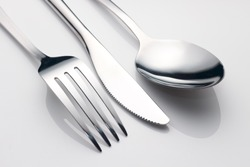 close up spoon, fork, knife
