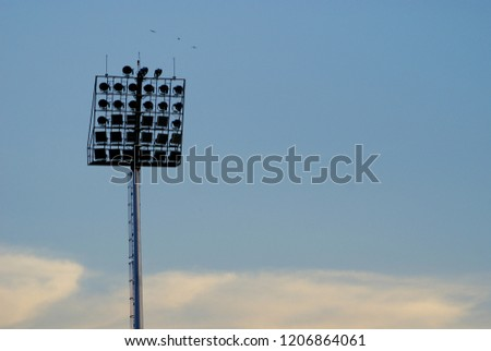 Close up spotlight installed around football stadium and prepare for football game with blue sky background #1206864061