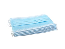 close up stack light blue surgical mask (medical face mask) with white rope strap for protective coronavirus (COVID-19) pandemic or PM2.5 dust particles isolated on white background