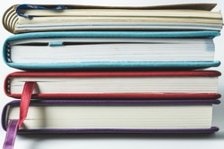Close up stack of books on white background