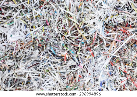 Close up stack of scrap paper from paper cutter for background