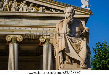 Close-up statue of the Greek philosopher Socrates on the background of classical columns #658126660