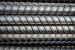 close up steel bar or steel reinforcement bar in the construction site ,steel rods bars can use for reinforce concrete.Background texture of steel rods used in construction to reinforce concrete.