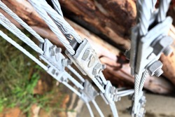 Close up steel turnbuckle and sling steel or Steel Wire Rope Sling and metal cable clamp connected with screw bolt in construction site. With selective focus.