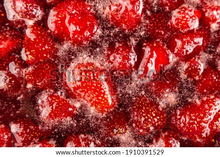 CLOSE UP: Strawberry jam. Make a strawberry jam. Boil strawberries in the pan. Process of cooking, boiling berries for canning. Healthy sweet food. Cooking strawberry jam close up.