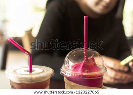 Close up  strawberry yogurt Smoothies on blurred woman background. #1123227065
