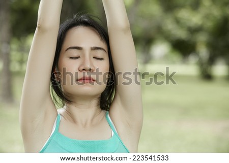 Close up stretching woman in outdoor exercise smiling happy doing yoga stretches after running-Beautiful happy smiling sport fitness