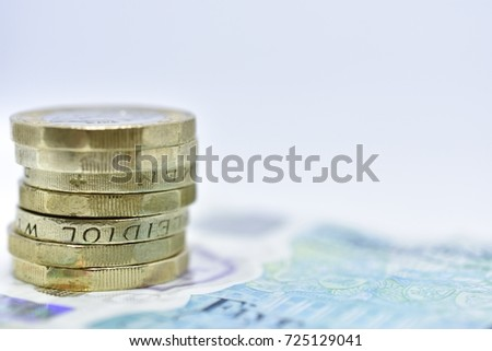 Close Up Study of British Sterling Coins Stacked on Sterling Paper Money #725129041