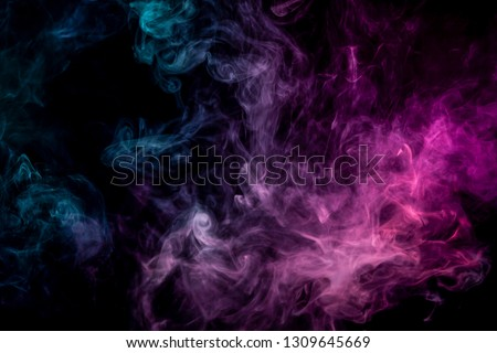Close up swirling pink and blue smoke on black isolated background  #1309645669