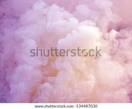 close up swirling pink and white smoke background