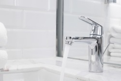 close-up tap or faucet in bathroom