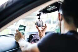 Close up Technician Hand with Car Camera and Smartphone Inside Car and Blur Man as a Foreground