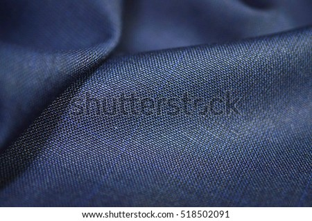 close up texture blue fabric of suit, photo shoot by depth of field for object