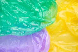 Close up Texture of a multicolor Plastic garbage Bag. Green Polyethylene Film. Texture of cellophane