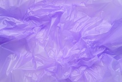 Close up Texture of a purple Plastic garbage Bag. Polyethylene Film. Texture of cellophane