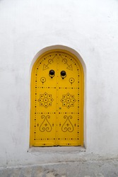 Close up texture of traditional ornamental Tunisian door, detail from typical Mediterranean Arabic architecture