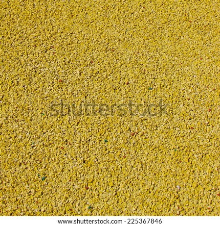 close up Texture of yellow color rubber floor on playground