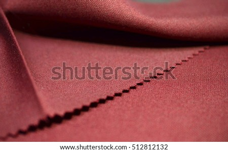 close up texture red fabric of suit, photo shoot by depth of field for object #512812132
