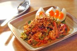 close up thai spicy seafood salad in ceramic dish