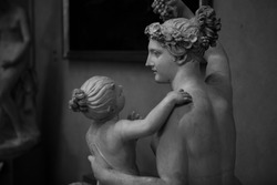 Close up. The black and white marble  Renaissance sculptures of a woman & a child created by the Italian artist Michelangelo at Galleria dell'Accademia in Florence, Tuscany, Italy. European art