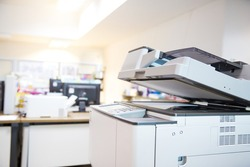 Close-up the copier machine in office copy room for scanning document printing a sheet and xerox photocopy and concepts of use a photocopier.