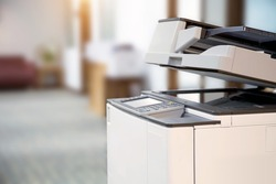 Close-up the copier or Xerox printer machine is office work tool in copy room for scanning document printout a paper and photocopy.
