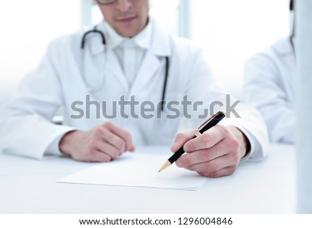 close up.the doctor makes a journal entry