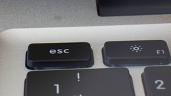 Close up the Esc key on the laptop keyboard