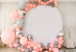 Close up the photo zone from pink and grey balloons with white copy space for your text. Party decorated with balloons