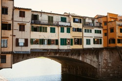 Close up. The Ponte Vecchio, or Old Bridge, is the medieval bridge with vintage stores and two-floor colorful buildings across the Arno in Florence (Tuscany, Italy). European architecture.