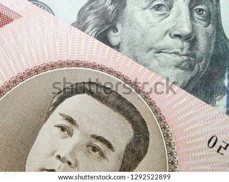 Close up the 100 United States Dollars with Franklin portrait & 100 North Korean won with Kim Il Sung portrait Stock fotó ©