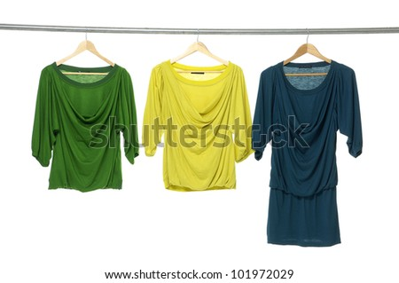 Close up three clothes on a hanger - stock photo