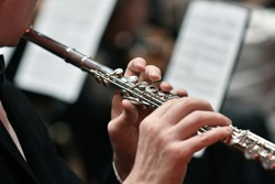 Close up tight shot of hand playing flute