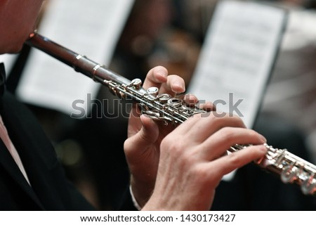 Close up tight shot of hand playing flute ストックフォト ©