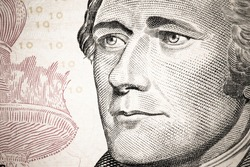 Close up to Alexander Hamilton portrait on ten dollar bill. Toned.