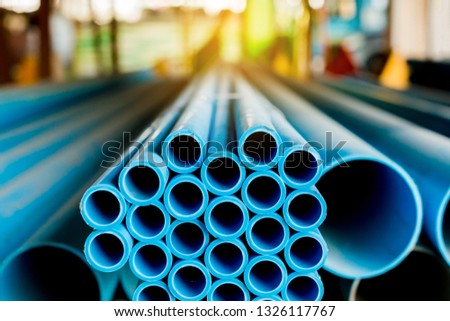 Close up to blue plastic pipe background, PVC pipes stacked in warehouse,  PVC water pipes used for construction Stock photo ©