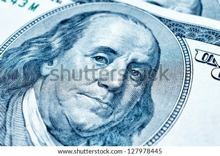 Close up to portrait of Benjamin Franklin on 100 dollar bill. Selective focus on face